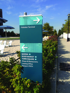 Newport community wayfinding with perforated aluminum. Design by Two Twelve. Fabrication and installation by DCL. #wayfinding #community #map #sign