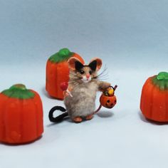 Very miniature little Halloween trick or treat mouse in cat costume with cat ears, tail, and very tiny sucker and pumpkin bucket filled with candy! Halloween Trick Or Treat, Happy Halloween, Pumpkin Bucket, Halloween Miniatures, Polymer Clay Animals, Mini Pumpkins, Cat Costumes, Cat Ears, Candy