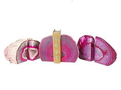 Pink Brazilian agate bookends $89  - The rocks & minerals nerd in me really wants these....