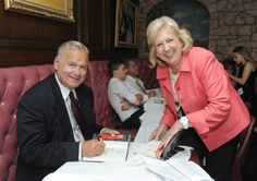 TANENBAUM LAUNCHES 'ECHOES' Last week at Forlini's restaurant in New York, author and criminal prosecutor Robert K. Tanenbaum hosted a launch event for his book Echoes of My Soul. Pictured is Tanenbaum signing copies for Linda Fairstein.