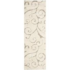 @Overstock.com - Ultimate Cream/ Beige Shag Rug (2'3 x 7') - This power-loomed shag rug offers luxurious comfort and unique styling with a raised high-low pile. High-density polypropylene pile features a cream background with beige accents and provides one of the most plush feels available in a rug.  http://www.overstock.com/Home-Garden/Ultimate-Cream-Beige-Shag-Rug-23-x-7/6372212/product.html?CID=214117 $52.45