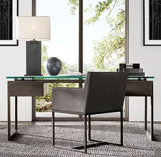RH's Latour Desk:A nod to the clean-lined aesthetic of 1970s French design. Constructed with open, angular drawer modules on either side, a glass desktop allows the rustic beauty of the bronze metal to take center stage.