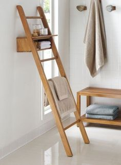 Loving this unique way to #store and hang #towels in a #bathroom!