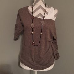 Brown off the shoulder Sweater Very Cute!!!! Off the shoulder sweater. Size Small. Necklace sold separately. Bundle and save 10%!! Poof excellence Tops