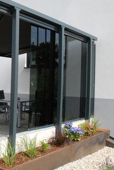 Freistehender Windschutz Glasschiebewand Terrasse