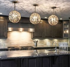 Round ceiling pendant lights look great over a kitchen island