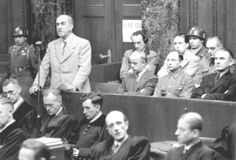 Oswald Pohl, former Chief of the SS Main Economic and Administrative Dept, (standing) is indicted on war crimes charges in connection with the operation of concentration camps at the Nuremberg Trials in 1947. After making numerous appeals, he was executed in Landsberg Prison on June 7, 1951,  SS-Wirtschafts-Verwaltungshauptamt