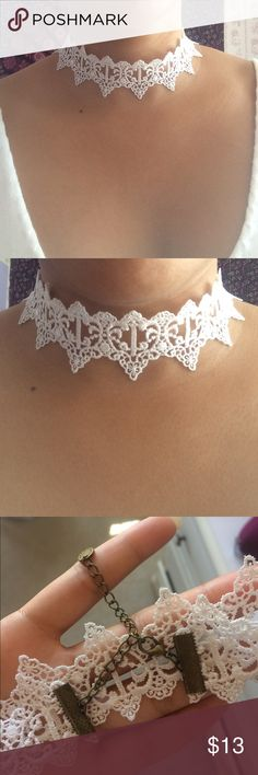 White lace choker Brand new. Never been worn. Has a bronze colored clasp. Jewelry Necklaces