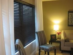 Spray painted faux wood blinds! Great way to change the look of a room on the cheap!