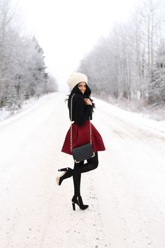White beanie, black sweater, maroon skirt, black crossbody bag & black booties. Convey The Moment.