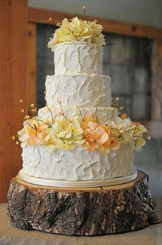 beautiful cake with a wooden pedestal--perfect for the Redwood Grove bride