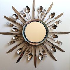 diy sunburst mirror with silverware. Do w/ old silverware set? Dollar Store Crafts, Dollar Stores, Thrift Stores, Goodwill Finds, Do It Yourself Upcycling, Silverware Art, Recycled Silverware, Starburst Mirror, Sunburst Clock