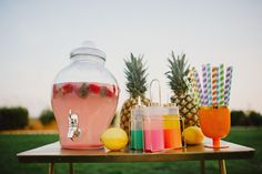 Always use beverage dispensers when you can when having a bit party! The Perfect Summertime Engagement Session Filled With Flamingos & Tropical Touches | Photograph by Hello Miss Lovely  http://storyboardwedding.com/summertime-engagement-session-flamingos/