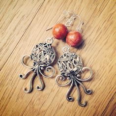 Octopus earrings with coral beads