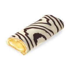 Imagina un bocado levemente crujiente por fuera pero que se derrite en tu boca tras el primer mordisco. Y dentro, una crema sabor vainilla. ¿Quién da más? Nuestras cañas de crema Zebra!