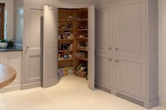 Corner pantry with convex curved doors - grey kitchen cabinets - Bespoke Interiors. Not so much the curved idea but a corner pantry. Kitchen Corner Cupboard, Kitchen Pantry Design, Kitchen Cabinet Storage, Grey Kitchen Cabinets, Kitchen Organization, Kitchen Ideas, Wall Cabinets, Pantry Storage, Kitchen Planning