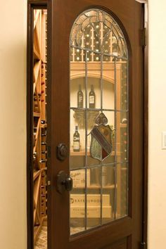 walk-in wine cellar with a vintage/salvaged leaded-glass door
