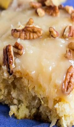 Pineapple Sheet Cake ~ flavored and moistened with crushed pineapple and topped with a sweet icing laced with shredded coconut, and sprinkled with pecans is a wonderful dessert to make to feed a crowd.