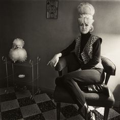 Lady Bartender at Home with a Souvenir Dog, New Orleans, Louisiana, United States, 1964, photograph by Diane Arbus.