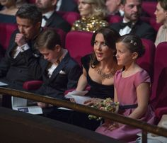 Crown Princess Mary and Princess Isabella discuss something going on at stage during the gala show.