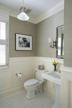 I love how the textured wallpaper balances out the tile and porcelain while keeping the palette elegant and sleek.