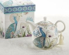 This Tea for One Teapot is a beautiful expression of art. The turquoise royal peacock spans the cup and teapot. An added flair of a tassel hanging from the handle brings this piece together. Arrives in matching decorated gift box with faux gem studded lid.  Porcelain