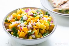 Mango salsa with fresh diced mango, red onion, jalapeno, cilantro and lime. Perfect with seafood.