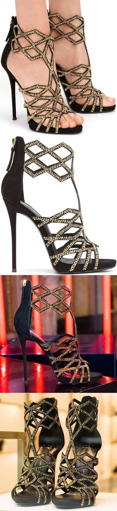 Do you love these black and gold-tone leather and suede 'Raquel' caged sandals as much as we do?