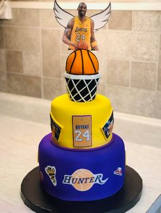 Remembering Basketball star Kobe Bryant with a three tiered birthday cake, topped with a smiling Kobe with angel wings 24th Birthday Cake, Birthday Cake Pictures, Happy Birthday, Cute Desserts, No Cook Desserts, Kobe Bryant Birthday, Basketball Cakes, Basketball Birthday Parties, Kobe Bryant Pictures