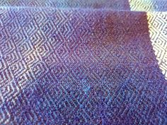 Handwoven qiviut, cashmere and silk. Close-up of scarf in stormy blue and turquoise tones.