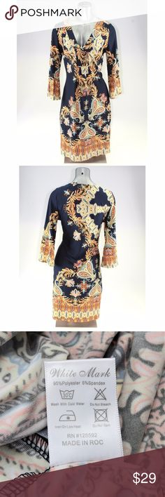 """Plus Size Navy & Gold Boho Printed Dress This bold patterned dress adds a splash of excitement to your daily wardrobe. This above-the-knee dress features a v-neckline, 3/4 bell sleeves, and an elegant draped fit. This bohemian dress measures about 41"""" around the bust and is about 39"""" long from shoulder to hem. #15WDAL Dresses Midi"""