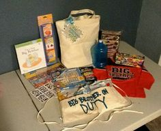 Big brother kit for rhyley that we will give to him when twins arrive. Stickers, cars, cookies, big brother book, big brother shirt, playdough,big brother on duty bathing tool belt, big brother water bottle, and flash card games. by Hailey Roberts