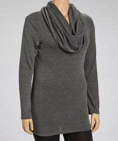 Show off those shoulders. This loose-fitting piece features a trendy neckline that exudes serious style.
