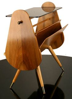 nowadays it could hold my iPad and laptop instead of magazines!  1950s midcentury magazine rack and side table.