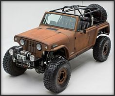 Rusted Terra Crawler - A gnarly off-roader built by Off Road Evolution for RCH Designs. Its frame and body were taken from a '69 Jeepster Commando, while the sweet faux rust paint was made by Loose Cannon Customs.
