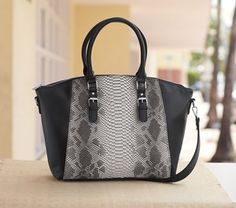 Reptile Tote from Monroe and Main.  A bag as artistic as it is functional, the feel is luxurious and the reptile pattern exquisite.