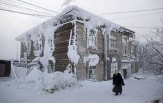 A frost-encrusted house in the city center of Yakutsk, Russia, January 2014. (Photo by Amos Chapple/REX Features)