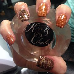Orange and brown glitter for Thanksgiving by @kristiandcharlinails!