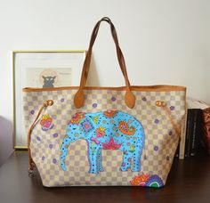 Louis Vuitton Neverfull customizada com elefantinho indiano.