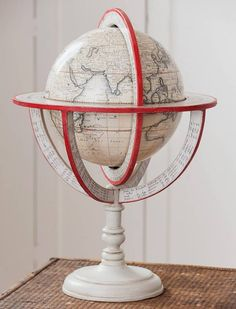 Lander and May French Meridian Globe ... black on white table globe using facsimile map artwork first published 1757 by  French globemaker Louis Charles Desnos, full meridian and horizon ring, wood pedestal stand, edges painted bright red, plaster globe covered with handtinted printed paper, c. 2016, UK