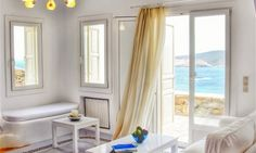 Luxury 5-bedroom rental villa facing Agios Sostis Beach in Mykonos Greece. White Villa with magnificent view of the sea, fully equipped bedroom, kitchen and bathroom is available for family vacation, private hire & wedding rental.