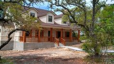 Cedar post on porches on pinterest cedar shutters porch for Texas hill country stone homes
