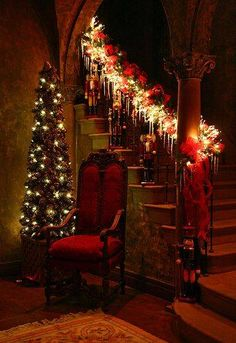 skinny Christmas tree, sparkling banister garland, vintage red chair. Jingle, jangle!