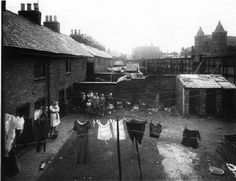This picture shows nos 2-26 Lower Grove Street Leicester. It was taken from the back bedroom of 19 Grovesnor Street and buildings in Belgrave Gate can be seen in the background. These houses shared back yards and three communal toilets. The families in this photo were rehoused on Hand Avenue and Gallards Hill on the newly built Braunstone Estate in 1938 and the houses were demolished.
