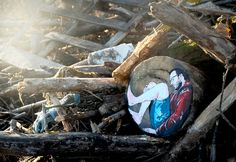 jana & js paint figures in the forest enclosed in tree trunk rings