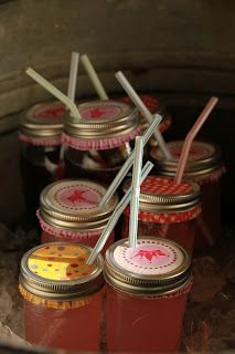 Mason Jar Glasses with scrapbook paper cut out to decorate the lids