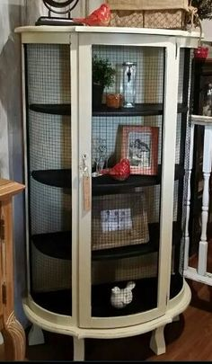 Old curio cabinet with mesh wire added to doors to replace broken/missing glass. (Patina Marquet, Willmar, MN)