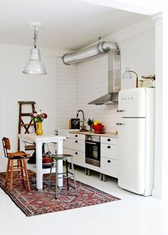 Create the illusion of a separate space in your kitchen with a rug or an island.
