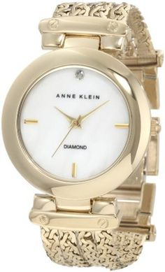 Anne Klein Women's 10/9794MPGB Diamond Dial Gold-Tone Chain Bracelet Watch Anne Klein. $95.00. Genuine diamond set at 12 o'clock. Gold-tone chain bracelet with accent screws on the lugs, jewelry clasp closure with extenders. Polished gold-tone case with hinged lugs. Gold-tone hour, minute and stick second hand. Genuine mother-of-pearl dial with gold-tone applied stick markers at the 3, 6 & 9 hours