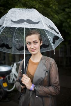 Street wear on a recent chilly day in Amsterdam.    need this mustache umbrella!